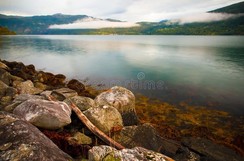 Stony bank of the fjord stock photo