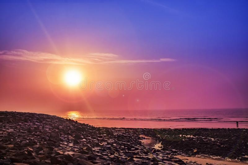 The Stony Beach with Silhouette with colorful Sunrise at the seabeach of east cost India. The Beach with Silhouette.. the sea beach of east cost India in the royalty free stock photos