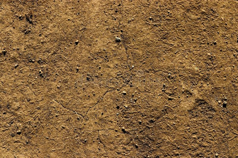 Stony clay ground hot dry background wallpaper. Stony clay ground hot dr background wallpaper stock photos