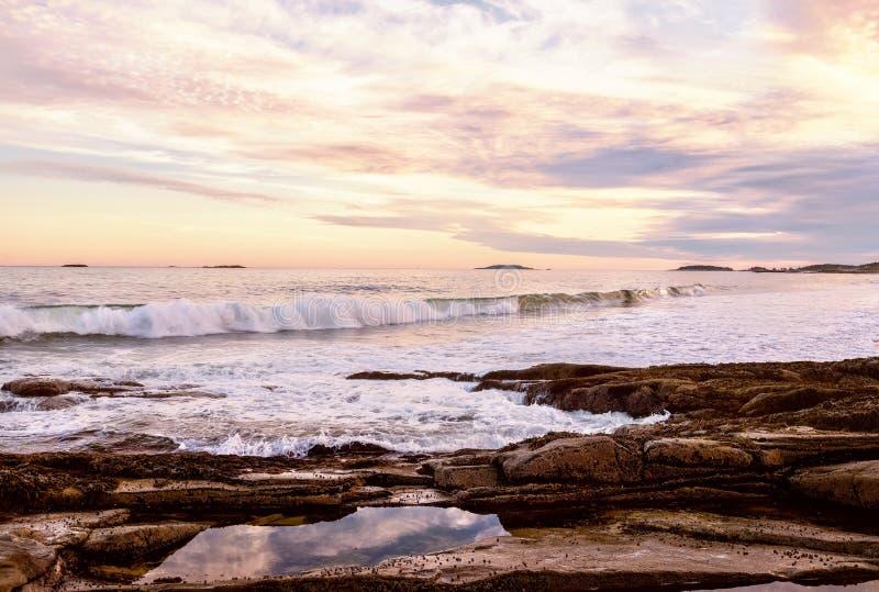 The stony coast of the Atlantic Ocean in the evening light. Deserted beautiful beach. USA. Maine. stock photography