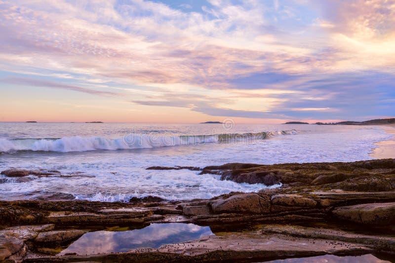The stony coast of the Atlantic Ocean in the evening light. Deserted beautiful beach. USA. Maine. stock image