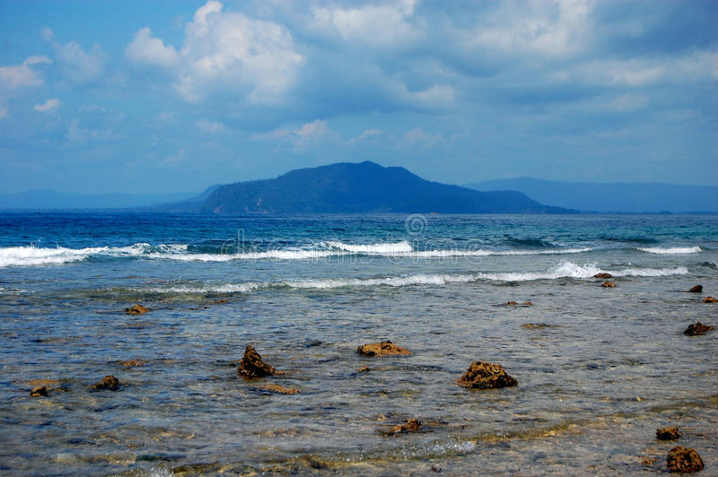 Stony coast at sea harbor, Indonesia. Stony coast at sea bay, Jayapura, Indonesia stock image
