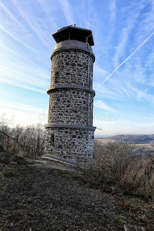 Stony outlook tower on the top of the Hill under blue sky. Stony outlook tower Bucina on the top of the Hill under blue sky stock photography