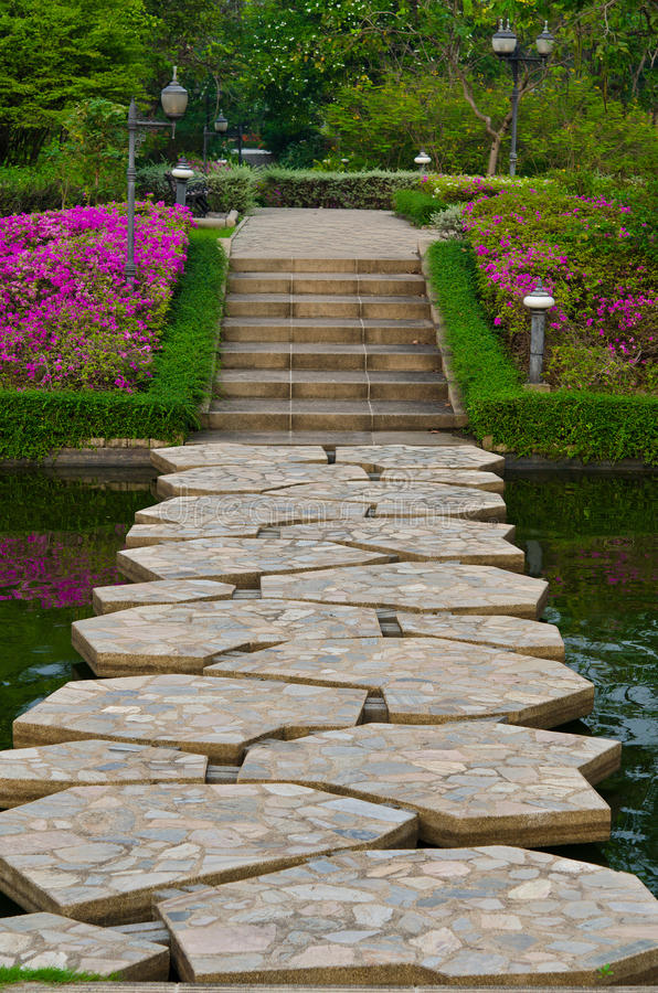 Stony Path through the garden. A bridge made of stone-jigsaw is a path thorugh the natural garden royalty free stock image