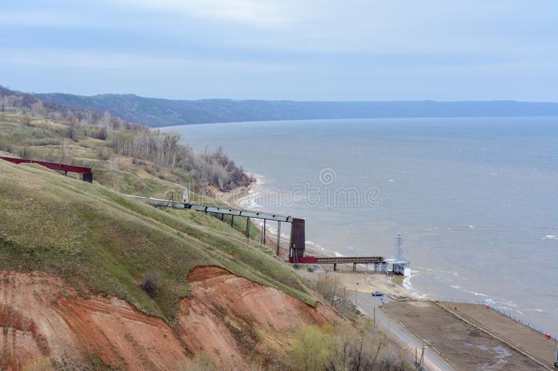 Stony, pebble and clay banks of the Volga River. Mountain slope of various stone rocks. Spring cloudy day with rain. Beautiful stock photography