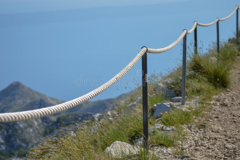 Stony road with rope fence on the peak Sv. Jure in Biokovo national park. Croatia royalty free stock images
