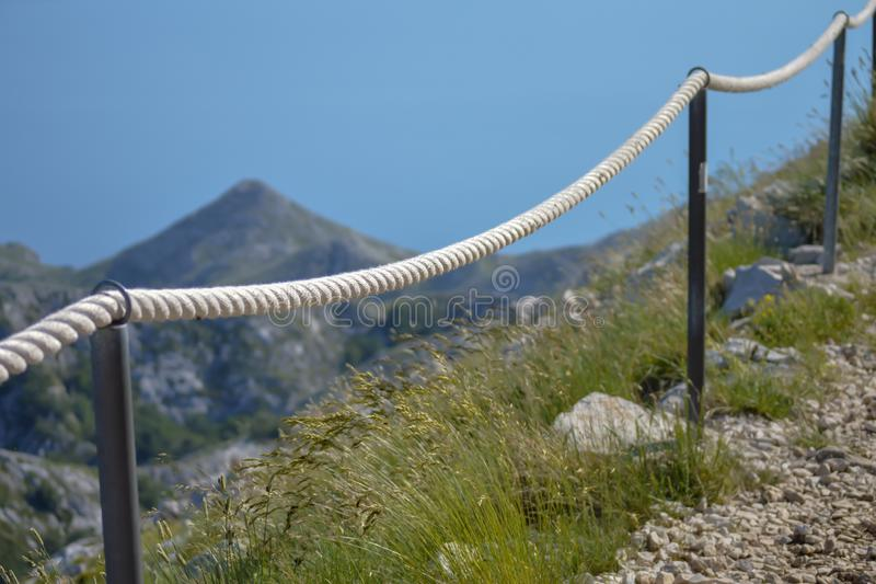 Stony road with rope fence on the peak Sv. Jure in Biokovo national park. Croatia stock images