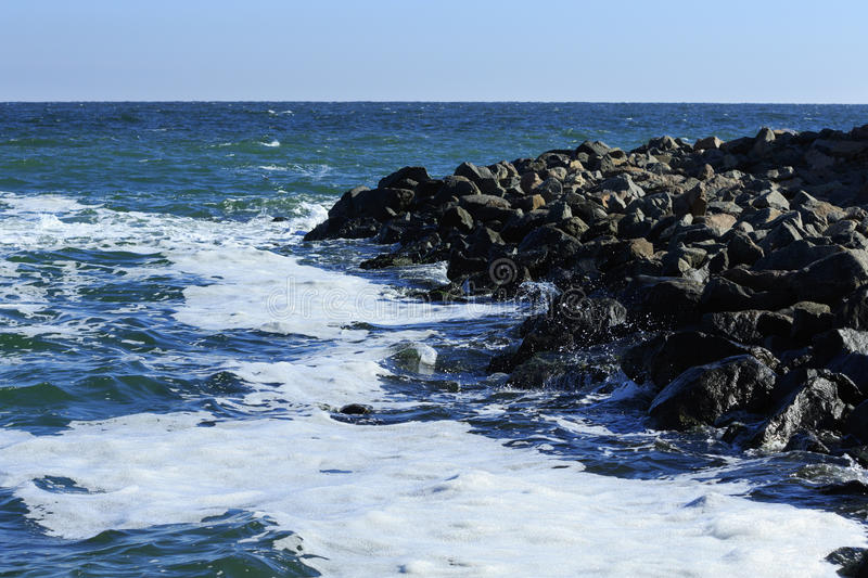 Stony seacoast royalty free stock photography