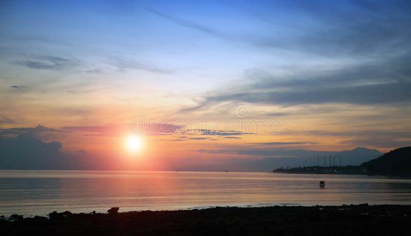 Stony seacoast on a sunset. Indonesia. Bali stock photography