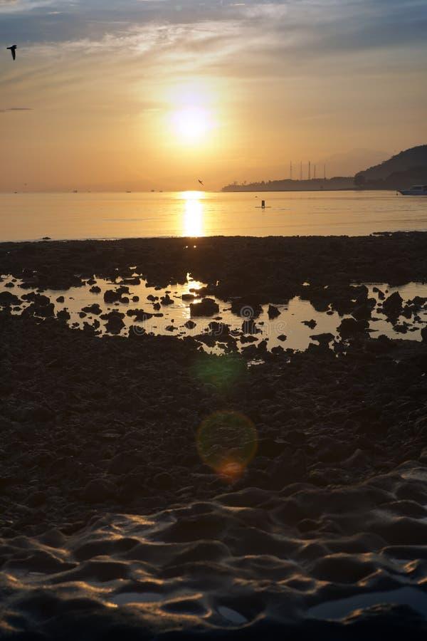 Stony seacoast on a sunset. Indonesia. Bali stock image