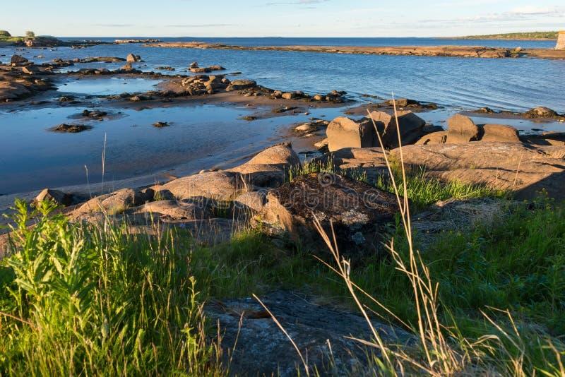Stony shore White Sea. Stony shore. Village of Rabocheostrovsk. White Sea, Kemsky District, Republic of Karelia, Russia royalty free stock images
