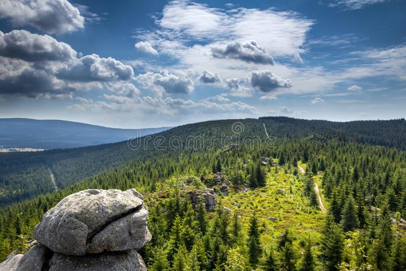 Stony viewpoint in Jizera Mountains under blue cloudy sky royalty free stock photo