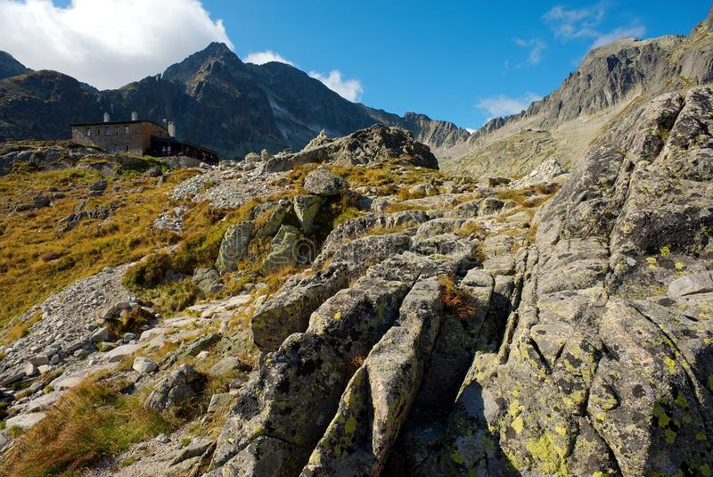 Stony walking path to a mountain cottage royalty free stock image