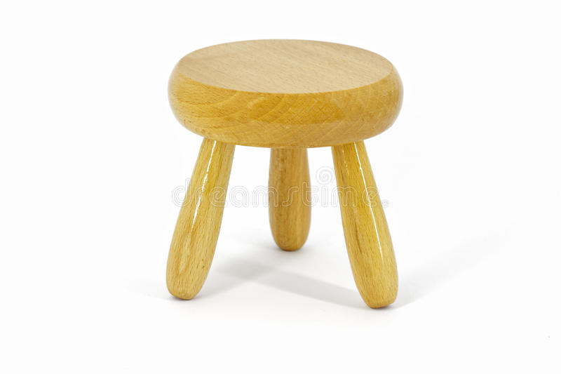 Stool. Small wooden stool isolated on white royalty free stock image