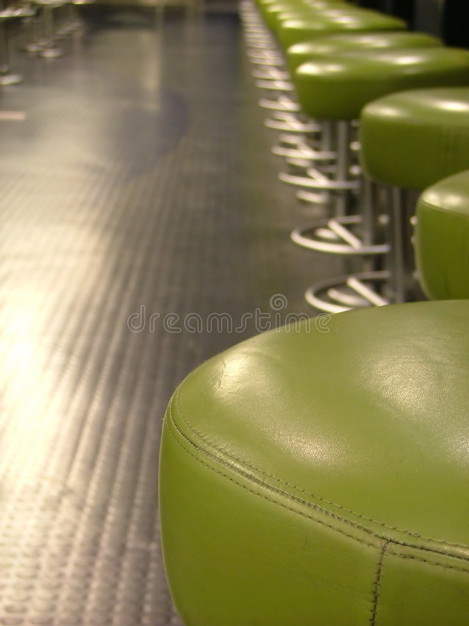 Stools on modern cafeteria royalty free stock photo