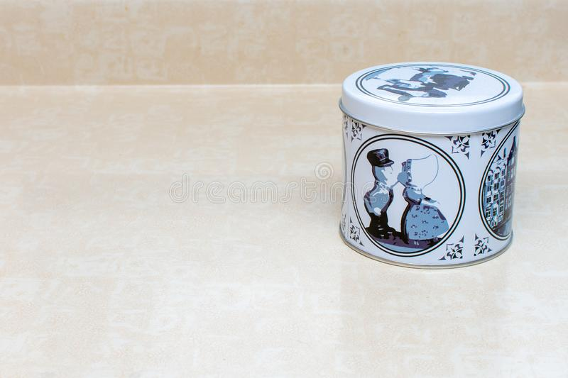 A stoopwafle delft blue tin for `syrup waffles` a Netherlands tea or coffee time snack on an isolated white off white background.  royalty free stock images