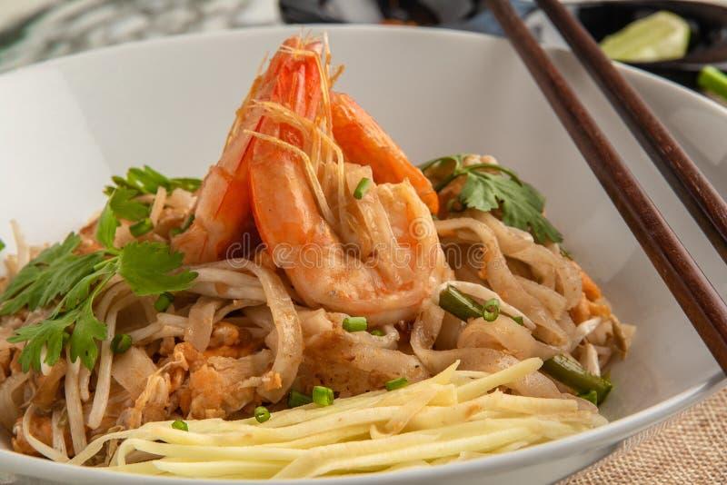 Stootkussen Thai Thaise stijlnoedels Thais voedsel - beweeg gebraden gerecht #6 stock afbeelding