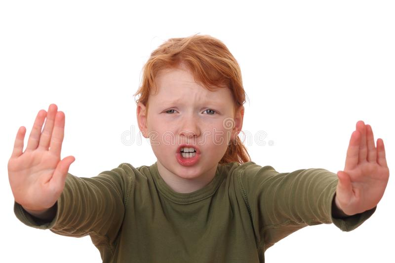 Stop. Portrait of a young girl making stop gesture on white background stock images