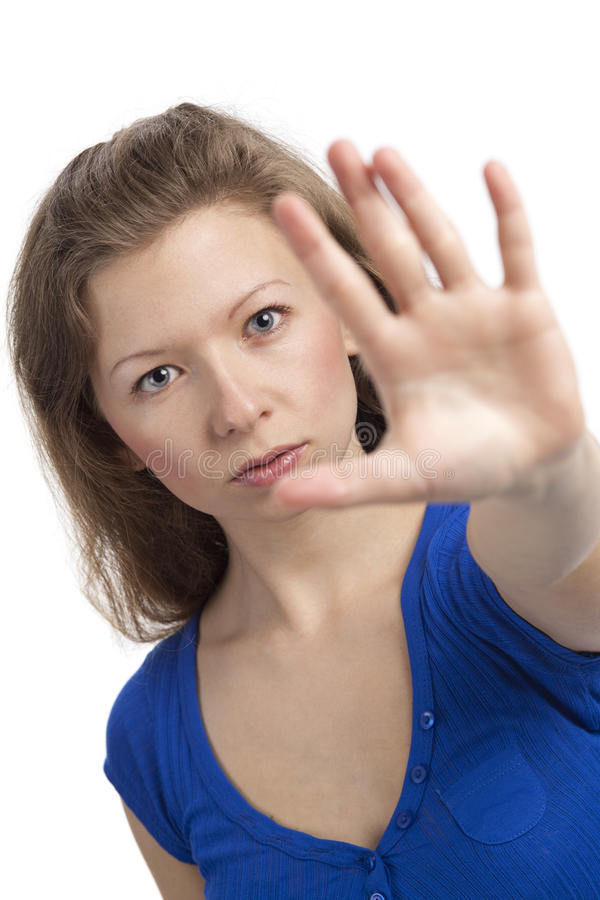 Stop. Serious young woman with hand raised to stop stock photo