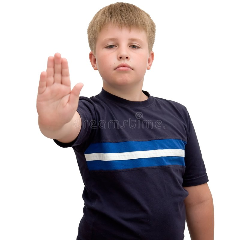 Stop. Image of young boy with hand outstretched, warding off any unwelcome situations royalty free stock image