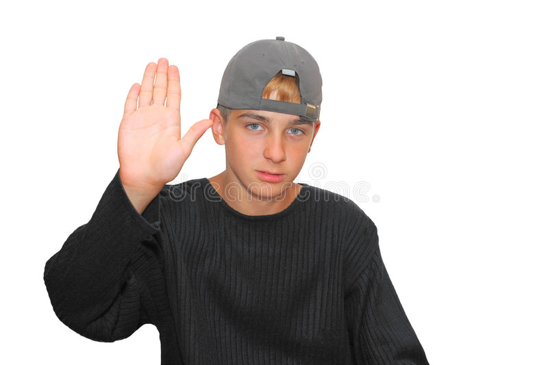 Stop. Teenage boy isolated on the white with hand out in stop gesture royalty free stock photo