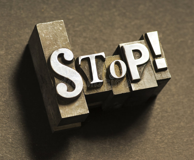 Stop!. The word Stop done in old lead type. Sepia toned for an antique look royalty free stock image