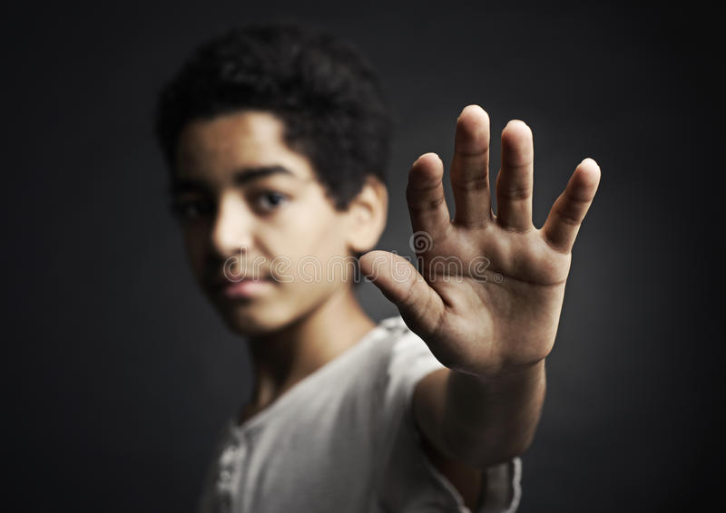 Stop. African teenager holds hand out as stop sign royalty free stock photography