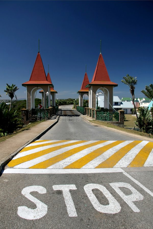 Stop for Bridge. Stop painted on road before narrow one way bridge royalty free stock photos