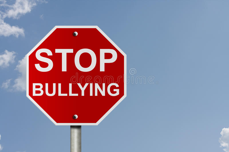 Stop Bullying. An American road stop sign with sky background and copy space for your message, Stop bullying royalty free stock photography
