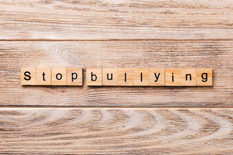 Stop Bullying word written on wood block. Stop Bullying text on wooden table for your desing, concept stock photography