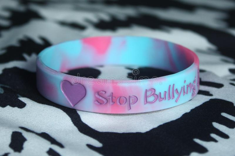 Stop Bullying Wristband. A silicone wristband with the words `Stop Bullying` to remind students to not bully royalty free stock images
