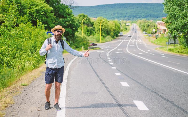 Stop car. Man try stop car thumb up. Hitchhiking one of cheapest ways traveling. Picking up hitchhikers. Hitchhikers royalty free stock image