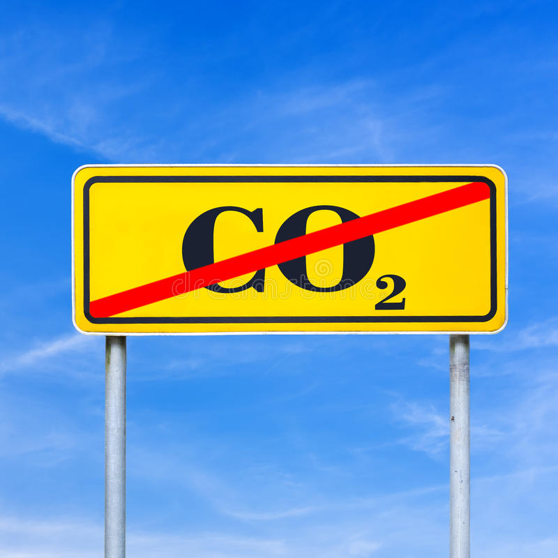 Stop CO2 emissions. CO2 sign crossed off on a yellow road sign stock photos