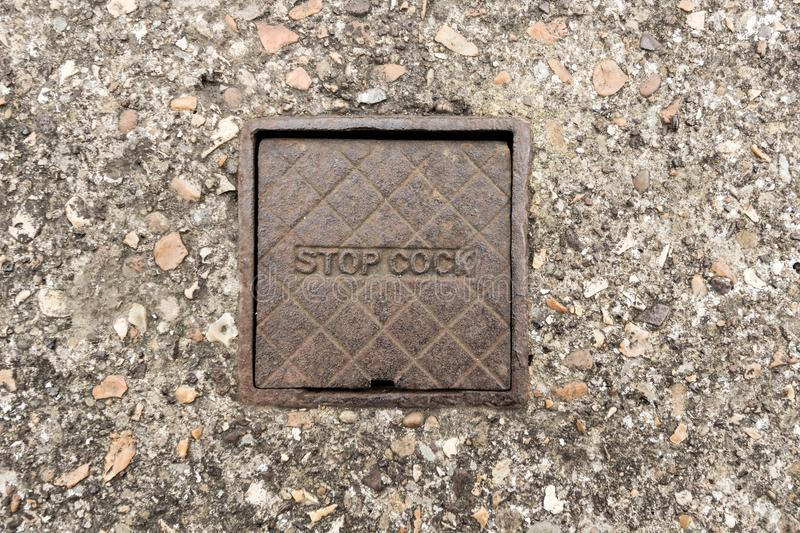 Stop Cover. Old cast iron stop cover in the ground royalty free stock images