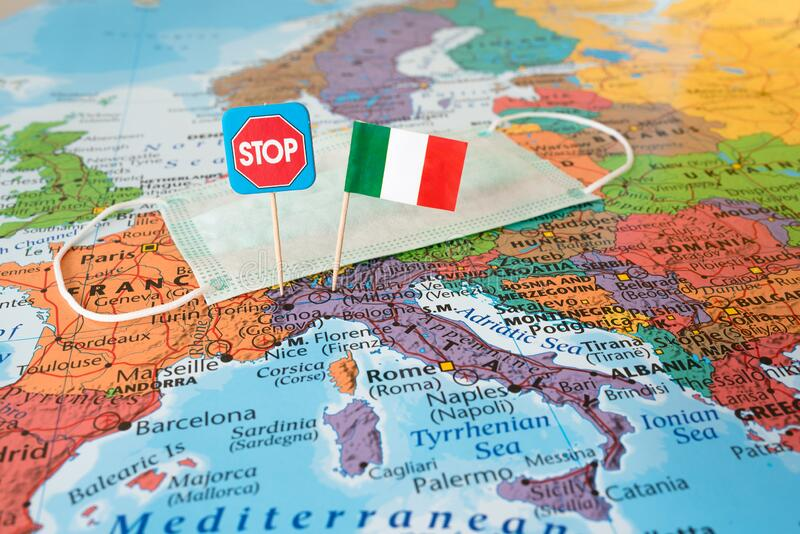 Stop Corona spread concept image, flag of Italy, hygienic face mask and stop sign on map, disease prevention. Stop Corona spread concept image, paper flag of stock image