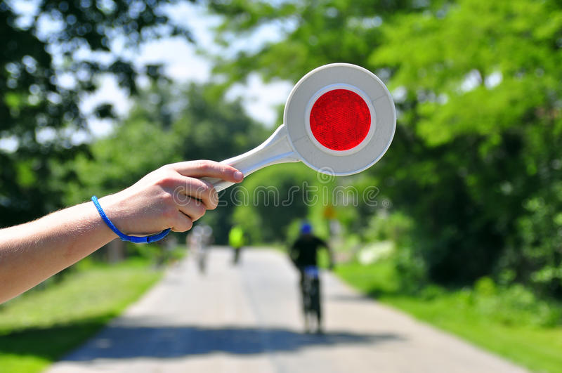 Stop cyclist. S - bringing the lollipop royalty free stock image