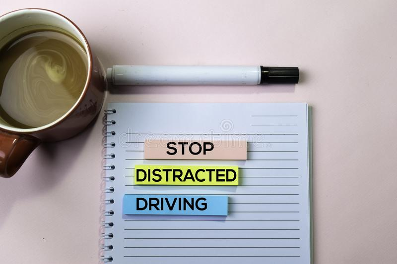 Stop Distracted Driving text on sticky notes with office desk concept royalty free stock photography