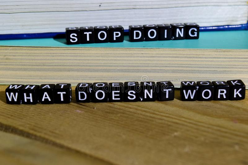 Stop doing what doesn`t work on wooden blocks. Motivation and inspiration concept. stock images