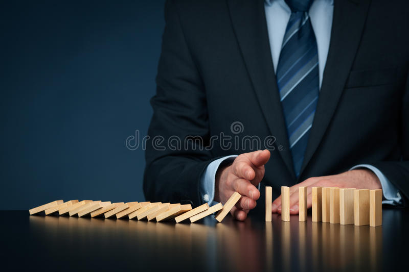 Stop domino effect and risk management royalty free stock photography