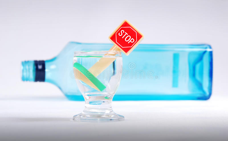 Stop drinking. Wine glass and bottle with stop sign stock photo