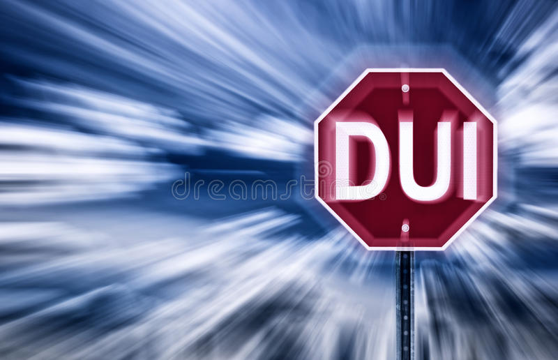 Stop DUI. Stop sign against a moody sky with the letters DUI printed on it. Image is blurred to imply motion and impaired vision due to intoxication royalty free stock photos