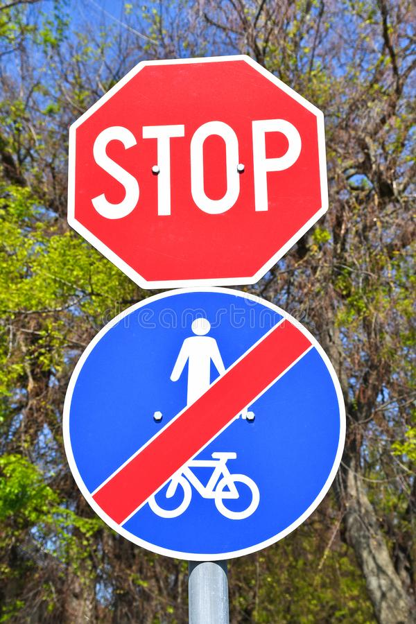 Stop and end of bicycle road traffic signs. Outdoors stock image