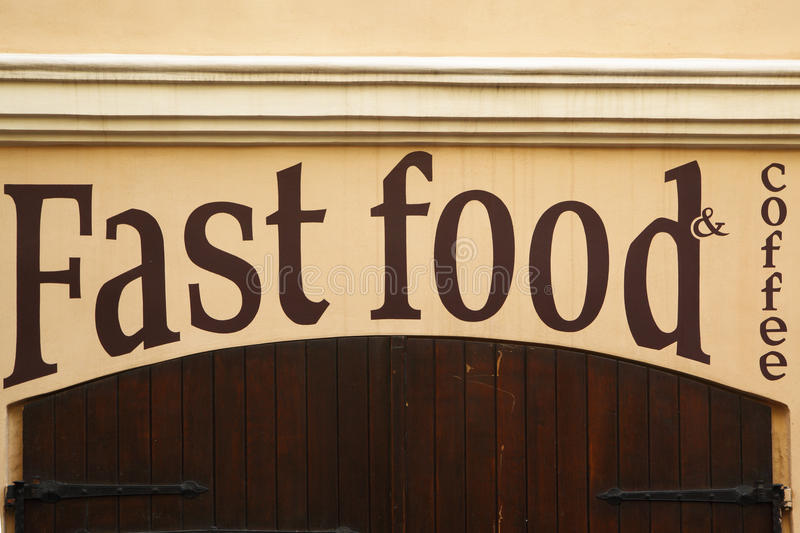 Stop fast food. Gate of closed fast food cafe closeup stock photos