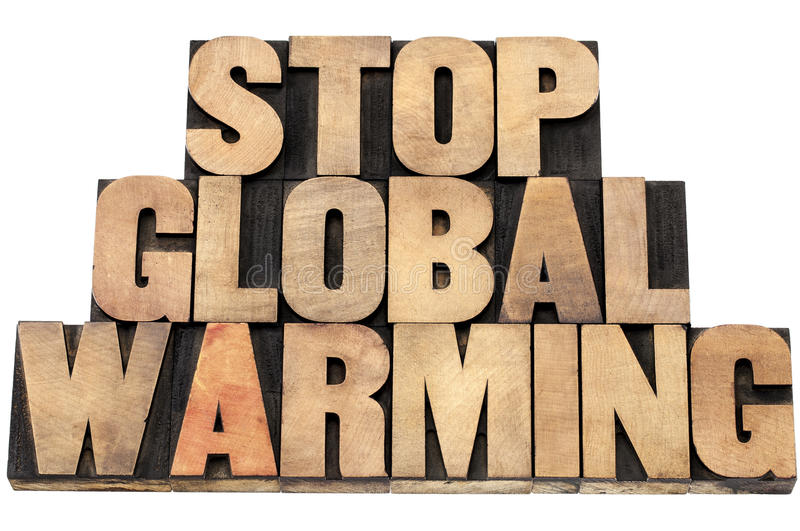 Stop global warming. Environmental concept - isolated text in letterpress wood type royalty free stock images