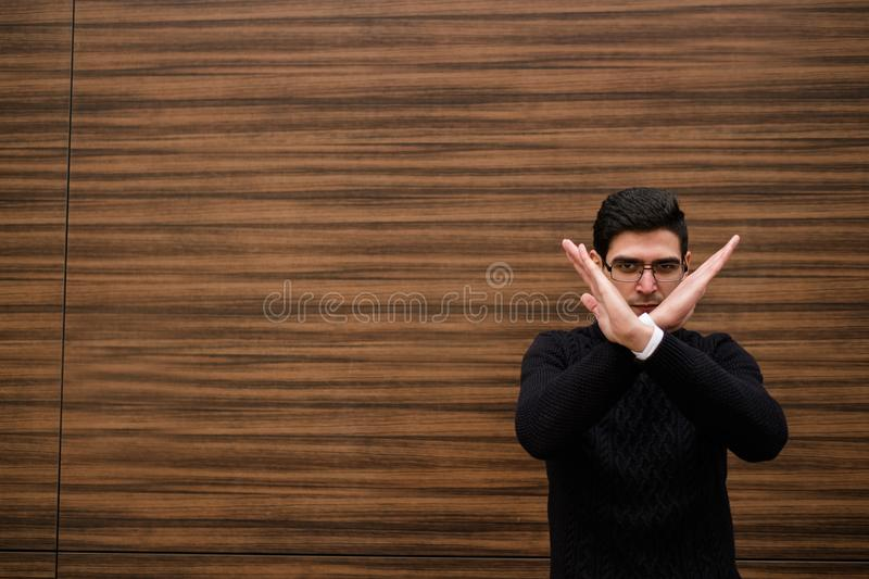 Stop hand gesture forbidden rejection decline. No stop hand gesture. wrong forbidden rejection decline. things to never do in business. wood texture wall royalty free stock photo