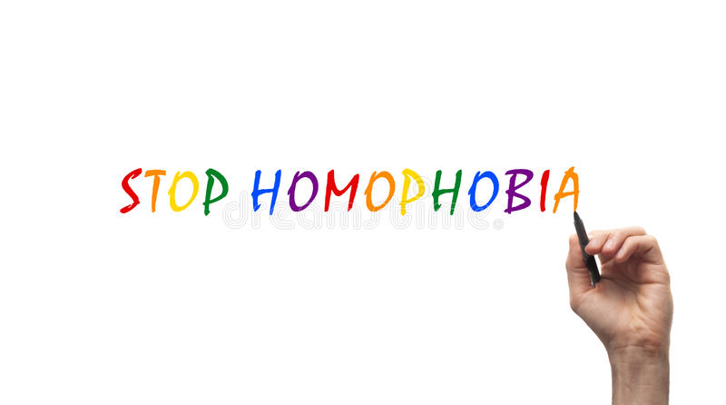 Stop Homophobia. Hand is writing a stop homophobia line in to the air royalty free stock photo