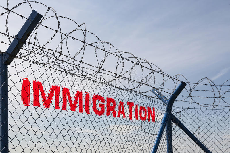 STOP IMMIGRATION, The Inscription On The Fence With Barbed Wire ...