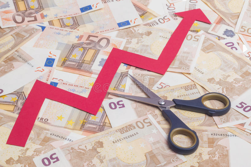 Stop increasing euro value. Concept. Scissor cutting growing arrow over fifty euro notes background stock photography