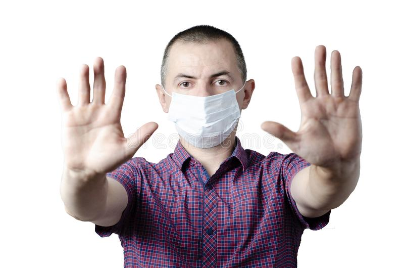 Stop the infection. Photo of man wear protective mask against infectious diseases and flu.  royalty free stock images