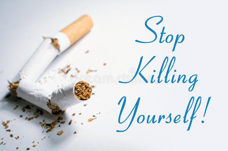 Stop Killing Yourself Smoking Reminder With Broken Cigarette In Whitebox. A Stop Killing Yourself Smoking Reminder With Broken Cigarette In Whitebox royalty free stock images